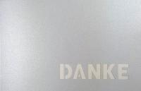 """Silberne Dankkarte mit ausgestanztem Schriftzug """"DANKE"""" und perlmutt Einlegeblatt"""
