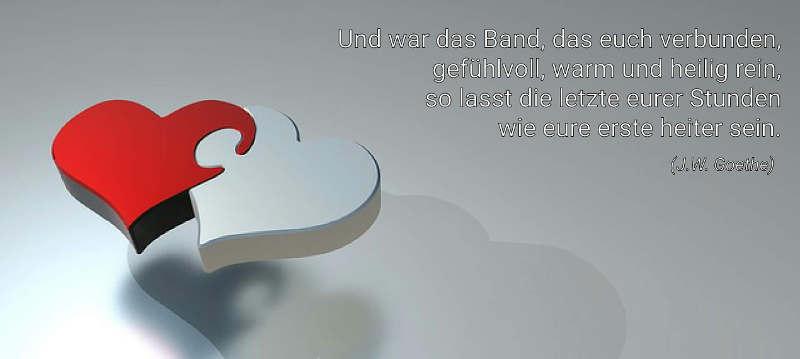 Zwei Herzen als Puzzleteile mit Liebes-Gedicht von Goethe