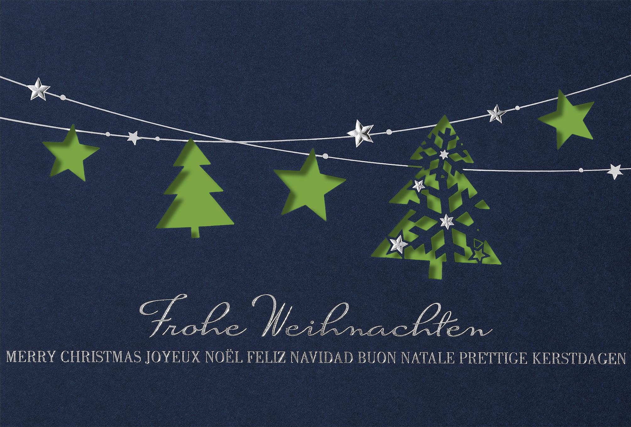 Internationale Weihnachtskarte blau mit grünem Einleger und Stanzung